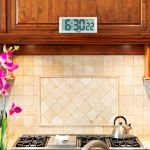 13.5-inch Timex Intelli-Time Extra-Large Digital Clock hanging in a kitchen - AcuRite Clocks