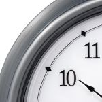 Close up of AcuRite 18-inch pewter illuminated LED outdoor clock with temperature and humidity