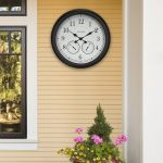 AcuRite 24 inch weathered outdoor clock hanging outside