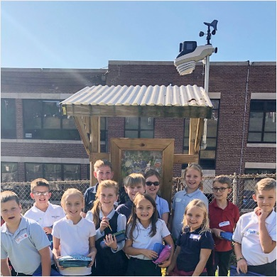 Children outside school with AcuRite Atlas Weather Station