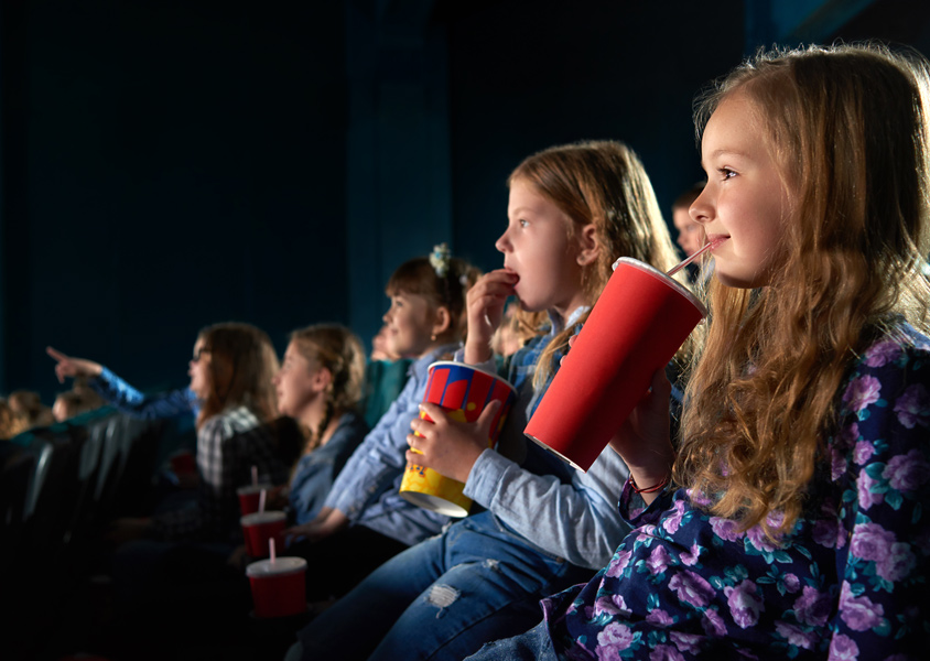 Children in a movie theater row