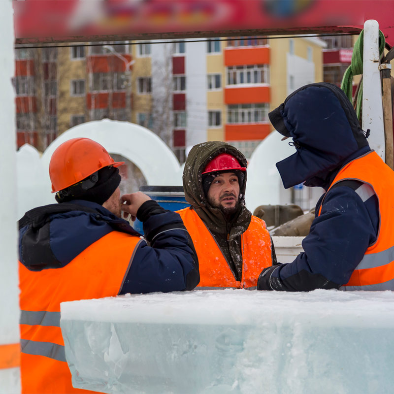 Construction workers at a site in the Winter