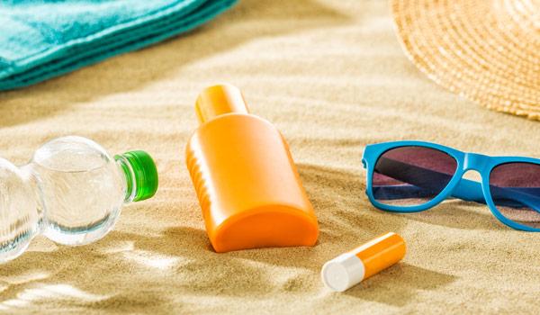 Beach items spread across the sand