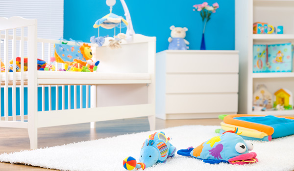 Child's room with crib, dresser and colorful toys
