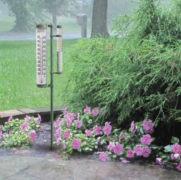 Analog rain gauge mounted in a yard