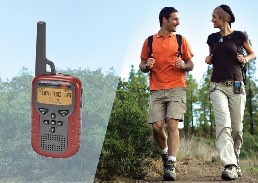 NOAA Weather Radio and couple on hike